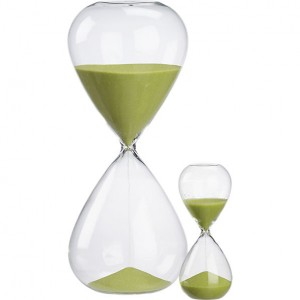 an hourglass with green sand